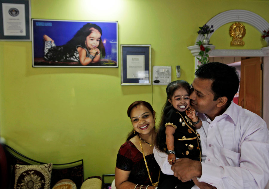 Джиоти Амге вкругу семьи. © Manish Swarup/AP Photo