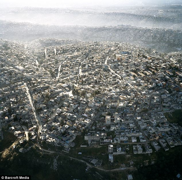 Endless: Homes far out endlessly from Mexico City and undulate in waves of humanity for miles around, creating the most populous city in the Western hemisphere