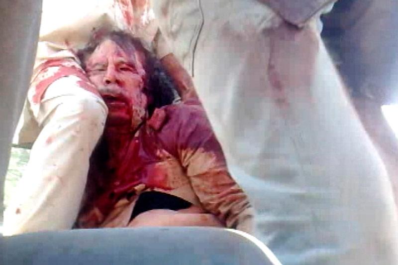 Накадре извидео Reuters TVтело Каддафи. © Reuters