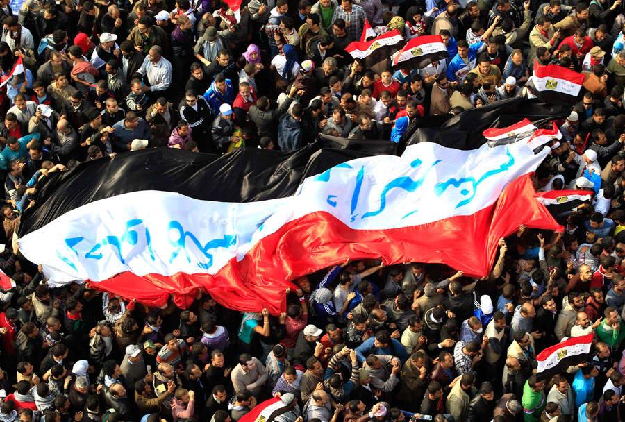 Египетские демонстранты наплощади Тахрир вКаире. © Ahmed Jadallah/Reuters