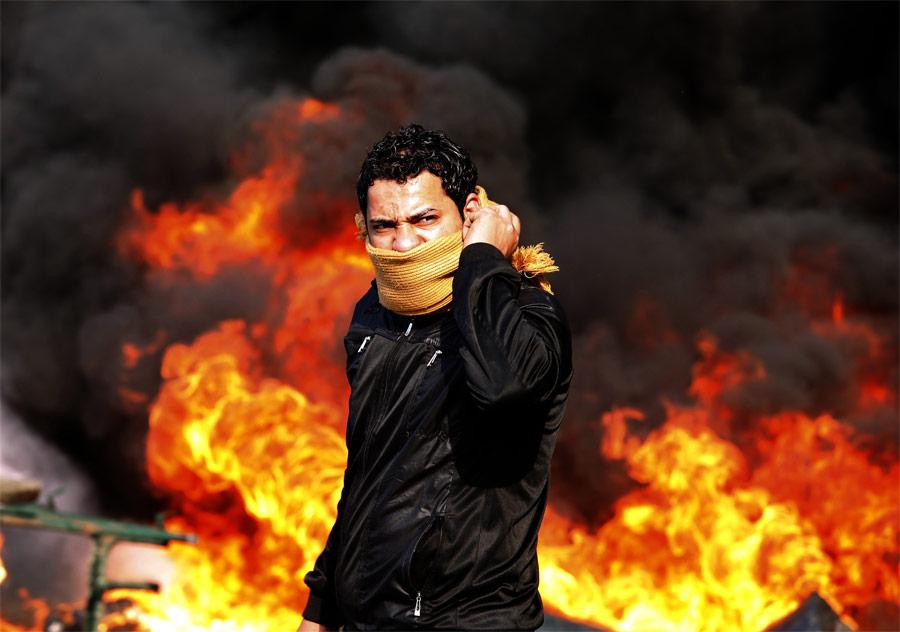 Горящие баррикады наплощади Тахрир вКаире. © Goran Tomasevic/Reuters