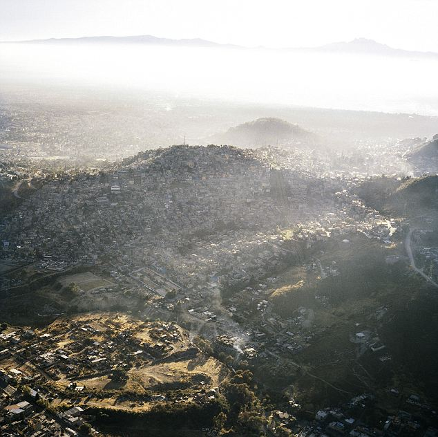 Hazy: Mexico City is also extremely polluted. Though smog has been drastically reduced in recent decades, an orangish fog often hands just above the sprawling city around the mountain peeks that surround it